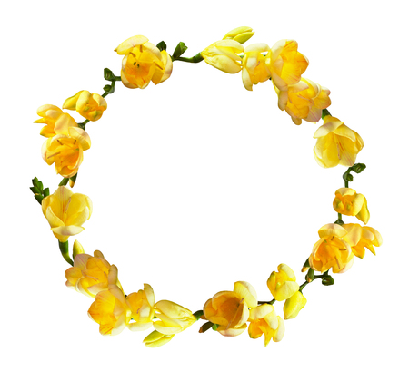 Round wreath with yellow freesia flowers isolated on white background