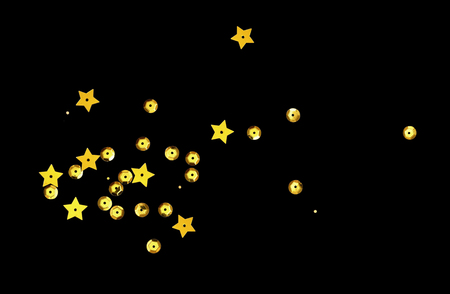 Scattered golden seqines and stars isolated on black background 版權商用圖片 - 117042054