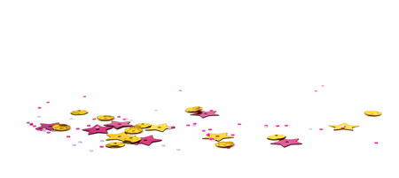 Scattered golden and pink seqines and stars on white background