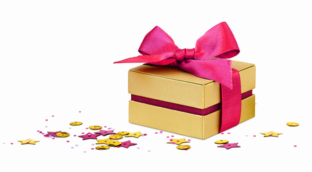 Gift box with scattered golden and pink seqines and stars on white background Stockfoto - 117042063
