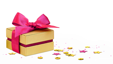 Gift box with scattered golden and pink seqines and stars on white background