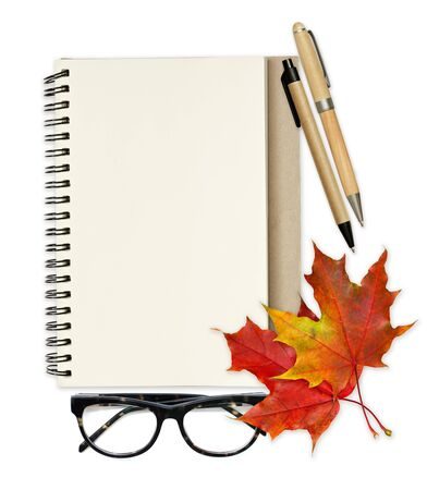 Empty notebook page, red maple leaves, pens and glasses on white background. Top view. Flat lay.