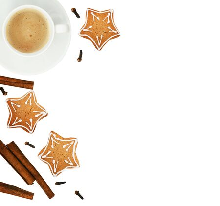 Ginger cookies, cup of coffee and fragrant Christmas spices isolayted on white background. Top view. Flat lay.