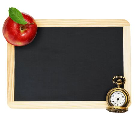 Black chalkboard , red apple and a clock isolated on white background
