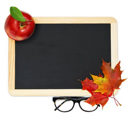 Black chalkboard , red maple leaves, apple and glasses on white background