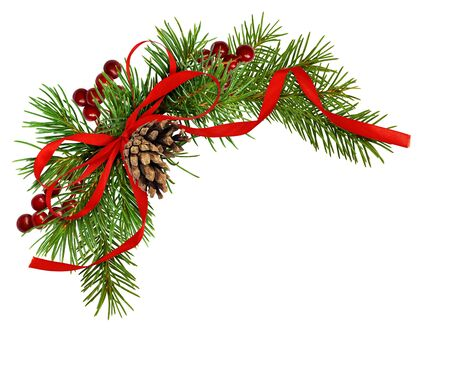 Christmas arrangement with pine twigs, cones, berries and red silk ribbon bow isolated on white