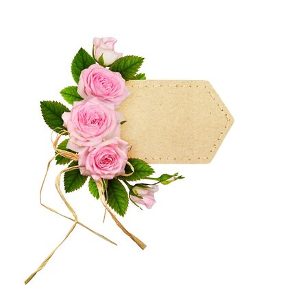 Pink rose flowers with green leaves in a floral arrangement on craft paper label