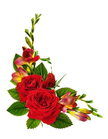 Red roses and freesia flowers in a floral corner arrangement isolated on white background