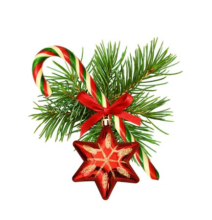 Traditional Christmas cane with pine twigs, decorative star and red silk ribbon bow isolated on white