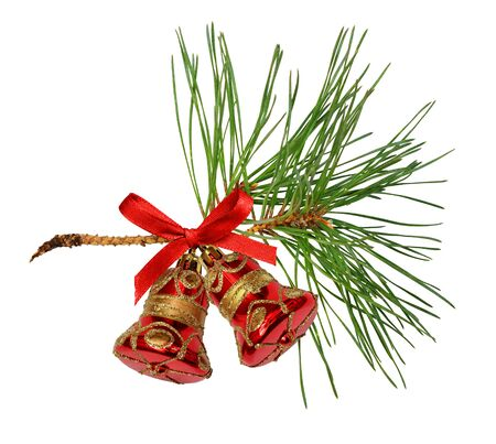 Pine twig with decorative Christmas bells isolated on white