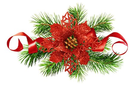 Artificial red glitter poinsettia flower, green pine twigs  and silk ribbon in Christmas arrangement isolated on white