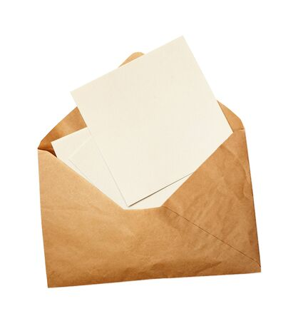 Opened craft paper envelope with empty pieces of paper isolated on white background Imagens
