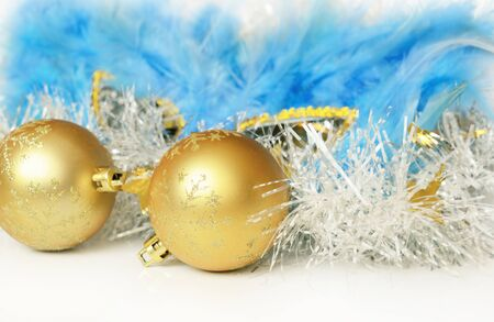 Christmas balls with tinsel and mask on white background Stock Photo