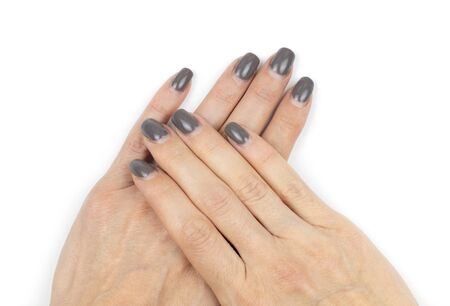 Overgrown shellac nails on female hands on white background. Lack of care during quarantine with closed beauty salons.