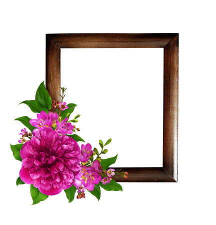 Pink peony and freesia flowers with green leaves in a corner of brown wooden frame isolated on white background