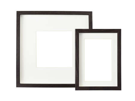 Dark brown wooden frames with white passe-partout isolated on white background. Mock-up.