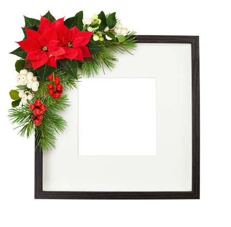 Dark brown wooden square frame with corner Christmas floral arrangement isolated on white background. Mock-up.