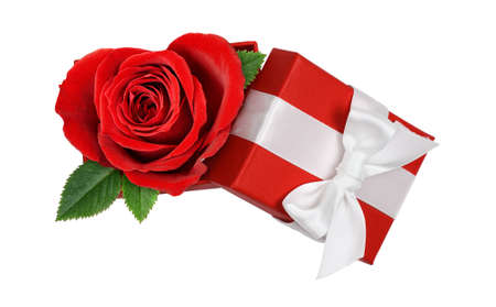 Open red gift box with heart shape rose flower and white satin ribbon bow isolated on white background. Top view.
