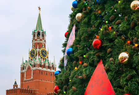 spassky: New Year tree against Spassky tower of Moscow Kremlin on Red Square Stock Photo
