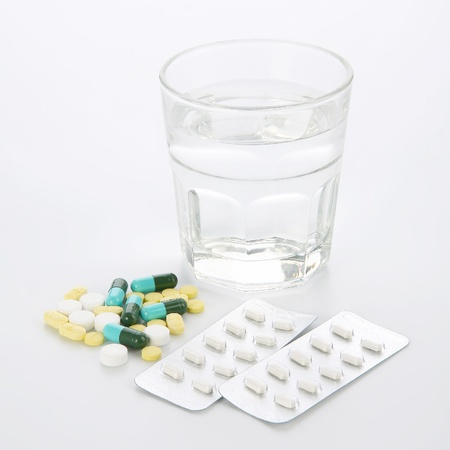 Glass of Water and Pills on white background  Stok Fotoğraf