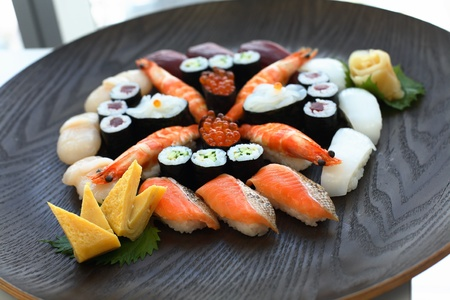 Set of sushi and rolls with a salmon  photo