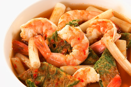 popular soup: Thai soup, Shrimp And Mixed Vegetable omelet in orange Spicy tamarind and spice Soup  kang som cha-om koong  Stock Photo