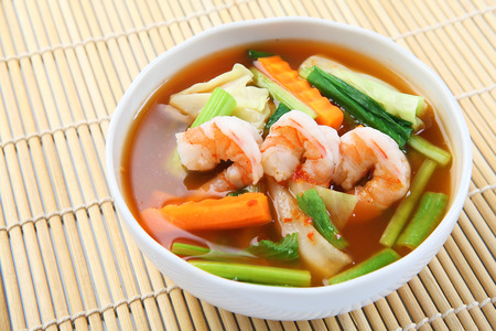 popular soup: hot and sour soup with shrimp and vegetables   Delicious thai traditional food  kang som koong