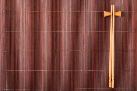 Two chopsticks on a bamboo mat
