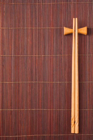 mats: Two chopsticks on a bamboo mat