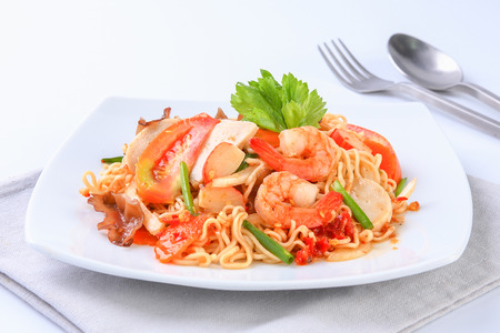 instant noodle: Instant noodle spicy salad on white plate