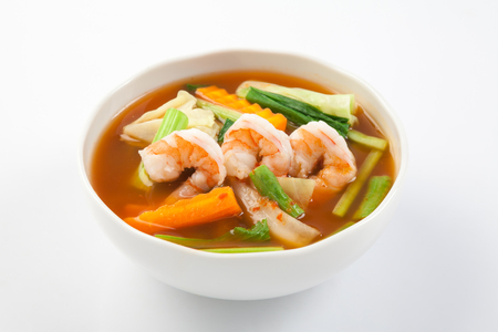 seafood soup: hot and sour soup with shrimp and vegetables, Thai Food Stock Photo