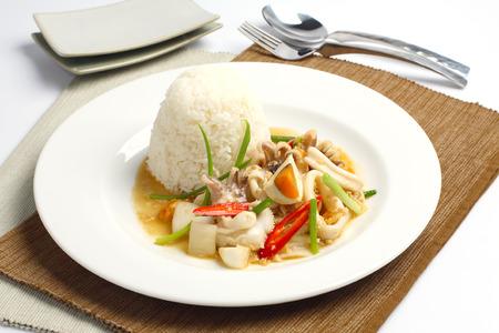 Stir fried squid with salted egg yolk over rice, Thai food