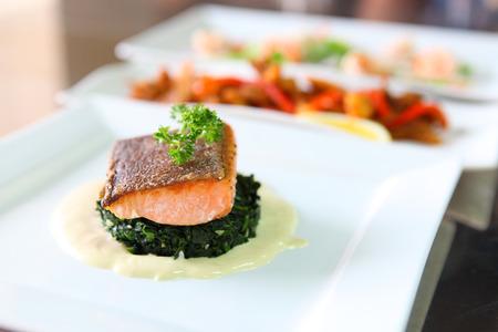 Grilled salmon steak on white plate Stock Photo