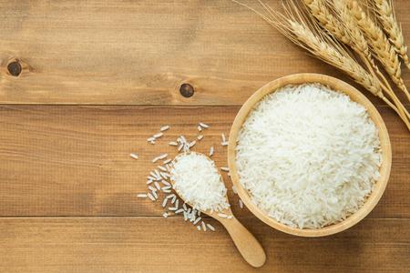 white rice (Thai Jasmine rice) in wooden bowl on wood background Stok Fotoğraf