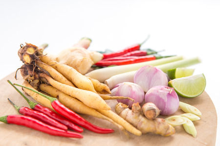 Spicy Thai food ingredients with wooden board Stock Photo