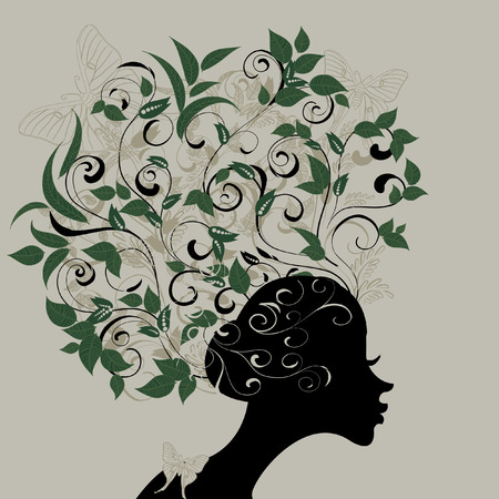 Profile of a girl with hair decorated with leaves Vector