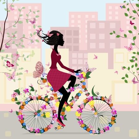 cyclist silhouette: Girl on a bicycle in the city