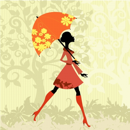 autumn fashion: beautiful woman with umbrella