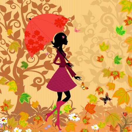 mujer bajo un paraguas en el otoño