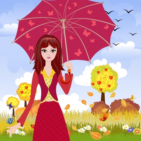 Girl with umbrella in autumn park photo