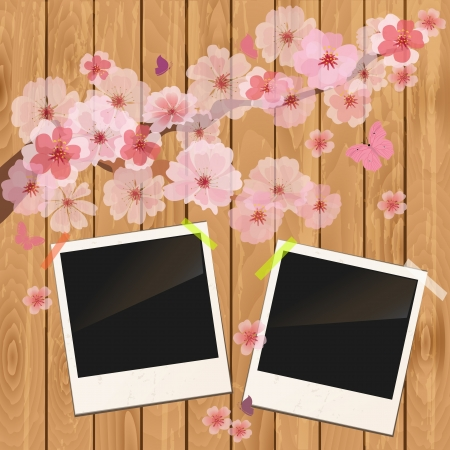 cherry wood: photo frame on wooden texture with cherry flowers
