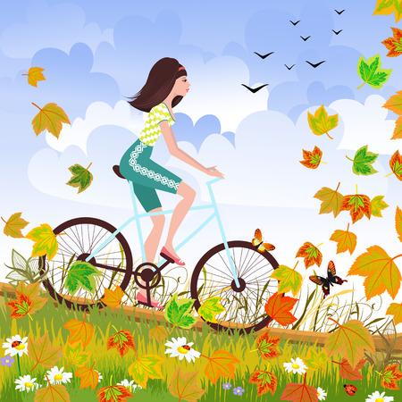 bicicleta: Bella joven está montando en una bicicleta en un bosque de otoño.