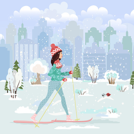 narciarz: happy young woman cross country skiing in city park