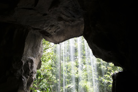 View from behind waterfall cave photo