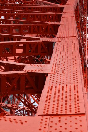 A close up of the  metal girders that make Tokyo Tower