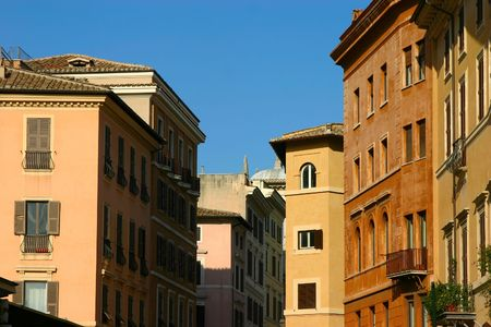 The multi-colored residential buildings in classic style of Rome Stock Photo