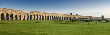 Claudian Aqueduct stretches to the horizon Stock Photo