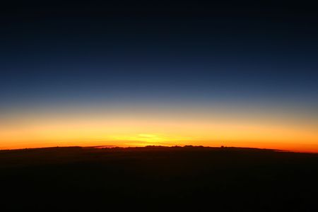 The dawn of new day showing the curve of the earth Stock Photo