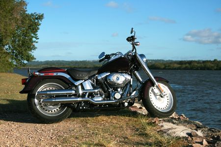 A classic looking motorcycle sits reflecting in the sun Stock Photo - 3765087