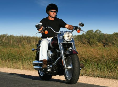 A man cruises on a classic style motorbike Stock Photo - 3758516